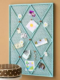 Inexpensive window grid inserts from a home center liven up this family bulletin board. Here?s how to make one of your own: Cut a piece of plywood to the size of the window grid insert and cover it with cork, batting, and fabric. Secure the fabric to the back of the plywood with a staple gun or finishing nails. Then nail the grid to the covered plywood and glue on buttons at the intersections