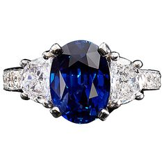 Vivid No Heat Madagascar Blue Sapphire Diamond Ring | From a unique collection of vintage three-stone rings at https://www.1stdibs.com/jewelry/rings/three-stone-rings/