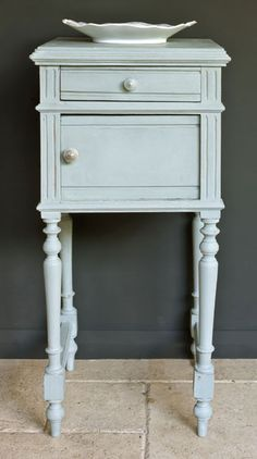 A side table painted in Duck Egg Blue against a Grahite wall for stylish French elegance