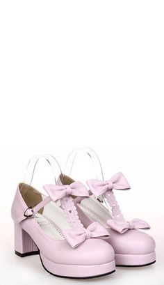 Dusty pink classic lolita shoes with cut out heart shapes around the top. The centre strap is in a matching heart design that fastens to the side with one heart buckle clasp. The shoes are finished with large bows to the front. The shoes are handmade from PU leather.   Heel: 6cm | Wedge: 2cm   100% official brand