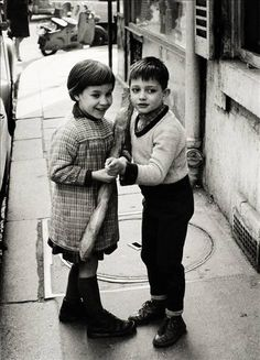 'Brother & sister coming back from a bakery with a baguette, Saint-Germain-des-Prés, Paris', by Harold Chapman