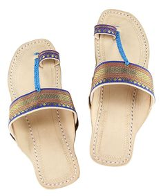 It's not just about staying royal, it's also about style and fashion. All those beautiful ladies who like maintaining their panache might want to pick up a pair of Kolhapuri sandals exclusively designed for them out of pure leather and enhanced with wonderful design. These sandals called as kolhapuri chappal are designed with elegance and they deliver the style and comfort.    Product Description and Care:    Attractive blue jari  upper authentic Kolhapuri Chappal for women with flat heel…