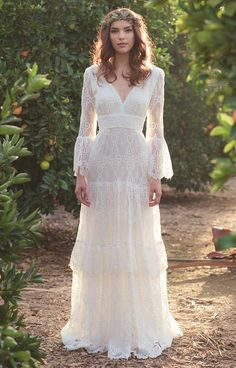 Musetta Bohemian wedding dress with long sleeves.