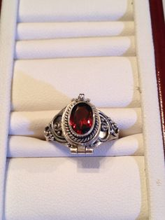 Items similar to SALE PRICED - Sterling Silver Garnet Poison Ring on Etsy