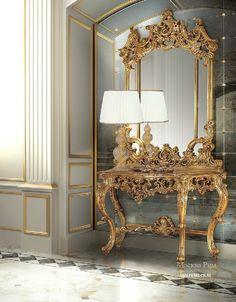 Консоль с зеркалом от итальянского производителя Angelo Cappellini. Столешница выполнена из мрамора. Каркас и ножки изготовлены из древесины и декорированы резьбой и позолотой. Дополняет консоль зеркало в резной раме.