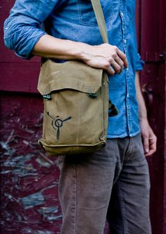 """A vintage Czech Military """"Bread Bag"""", khaki brown canvas wooden toggles to keep everything safe and secure...The interior is divided into three open bottomed compartments, and it even has a small pocket on the divider, perfect to keep your keys from the chaos of everything else you stuff in this bag.  The bag measures approximately 11"""" tall, 9 1/2"""" wide, and 3 3/4"""" deep. The fully adjustable strap is 1 1/2"""" wide and measures from 23"""" up to 42"""" long."""
