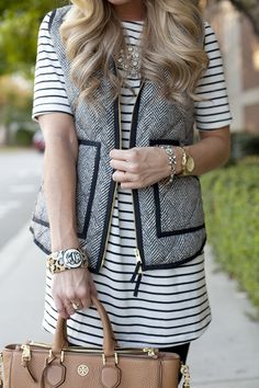 Layer a contrast trim vest over a striped T-shirt or tunic. Wear the combo over leggings and boots for a comfy, fall look.