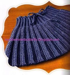 The neck of the capelet becomes the waist on this pleated-look skirt. It can be made in any size from infant to adult all you have t… - The neck of the capelet becomes the waist on this pleated-look skirt. Crochet Dress Girl, Knit Baby Dress, Crochet Skirts, Crochet Baby Shoes, Knit Skirt, Crochet Clothes, Knit Crochet, Toddler Skirt, Baby Skirt