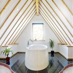 A 'wow' factor bathroom in the eaves | Bathroom suites that make the most of awkward spaces | housetohome.co.uk