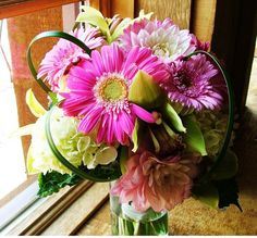 This bouquet contains orchids, dahlias, hydrangea, lily grass, and gerbera daisies. (Photo by Petal and Bean)