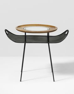 Mathieu Matégot; Enameled Steel, Oak, Glass and Brass Occasional Table by Atelier Matégot, c1950.