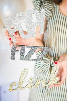 Just say yes to a set of DIY pop fizz clink New Year's Eve party photo booth props.