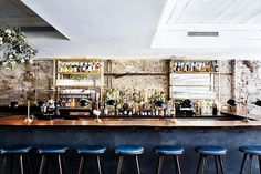 How cool is this #vintage-inspired #restaurant design? Especially love the blue #barstools!