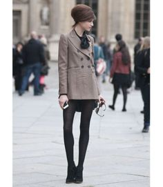 Classic black tights add a touch of class to an already impossibly chic outfit.