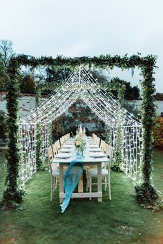 Fairy lit canopy over wedding table, set up in garden with blue silk runner. Canopy Lights, Light Canopy, Top Table Ideas, Unique Wedding Stationery, Copper Lantern, Ribbon Bouquet, Walled Garden, Wedding Table Settings, Outdoor Furniture Sets