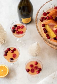 An easy citrus holiday punch made with grapefruit, oranges, Prosecco, gin and some hard seltzer! It's perfect for a holiday party and takes 10 minutes to make! Christmas Eve Dinner, Christmas Entertaining, Christmas Cocktails, Christmas Desserts, Holiday Punch Recipe, Holiday Recipes, What Is Simple Syrup, Punch Recipes, Drink Recipes