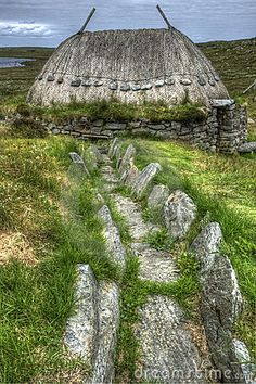 """Vikings: ~ Small thatched stone structure in Shawbost, Isle of Lewis, that was originally a Norse Mill, showing the mill lade structure where water was channeled along to drive the mill."