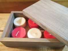 Rustic wood box with 6 tea light candles. Candles are handmade also. https://www.etsy.com/listing/168837841/rustic-wood-box-tea-light-candle-hostess?ref=shop_home_active #rusticbox #box #woodbox #rusticdecor #gift #candles