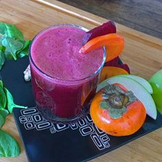 """Drink an energizing and healthy Beet, Persimmon, and Spinach Juice. The results are un""""BEET""""able! Every Fall, the beautiful and delicious persimmon is seasonally abundant. Juice Smoothie, Smoothie Drinks, Smoothie Bowl, Smoothies, Spinach Juice, Celery Juice, Healthy Drinks, Healthy Eating, Just Juice"""