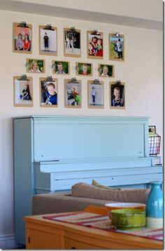 now who would have ever thought of using clipboards to display family photos on a gallery wall?  what a great idea!