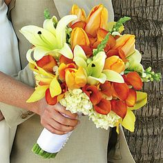 falling for the dark orange flowers (calla lillies?), also like the white flowers at the bottom (hydrangeas?)