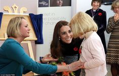 Once inside, the Duchess of Cambridge was presented with a bouquet of flowers by Tilly Penhale, four from Cheltenham during her visit to The Nelson Trust Women's Centre in Gloucester