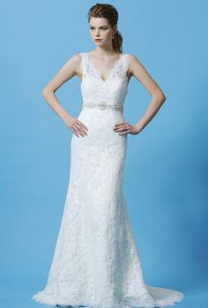 Brides: Eden Bridals. Gorgeous Royal Duchess satin and lace with crystallized beading accenting the natural waist. This sheer V-neck lace gown is made sheath and finished with chapel length train