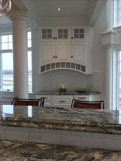 The raised area of this island boasts a laminated double ogee edge. The granite is Viscont White and looks stunning on these Plain & Fancy cabinets. Kitchen Backsplash Panels, Ceramic Tile Backsplash, Tile Countertops, Laminate Hardwood Flooring, Allure Vinyl Plank Flooring, Floor Design, Ogee Edge, Person Search