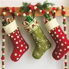Felt Christmas Stockings, LOVE the Pom Pom Garland too! Merry Little Christmas, Noel Christmas, Winter Christmas, Handmade Christmas, Felt Christmas Stockings, Christmas Chocolate, Elegant Christmas, Green Christmas, Outdoor Christmas