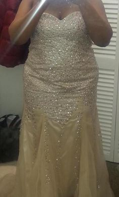 Champagne colored plus size wedding dresses can be made for a more evening wedding.  This strapless bridal gown has many beads on the bodice.  Get info on totally custom #plussizeweddingdresses and replicas at www.dariuscordell.com