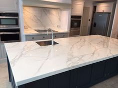 he Marble Group think that Neolith is one of the most aesthetically pleasing brands of kitchen worktops. Made from Ultra-Sintered technology, commonly called ceramics, Neolith is extremely durable and the Calacatta version is very natural looking marble replica.