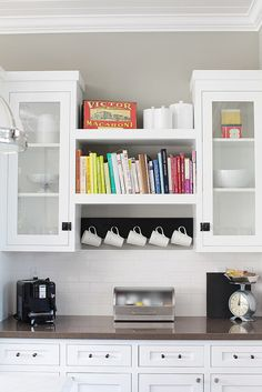 Hang mugs from a coat rack to free up cabinet space.