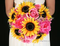 Yellow sunflowers with pink roses and wax flower make a stunning brides bouquet perfect for that outdoor wedding