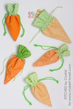 Stitched by Crystal shares her free sewing tutorial at Make It & Love It to sew these adorable carrot treat bags.