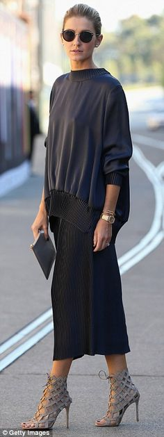 Fashion-off! Kate Waterhouse (R) was as stunning as ever in a navy Christopher Esber ensem...