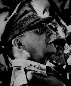 General MacArthur surveys the beachhead on Leyte Island, soon after American forces swept ashore from a  gigantic liberation armada into the central Philippines, at the historic moment when the General made good his promise 'I shall return.' 1944.