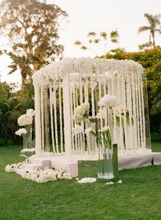 Beautiful! Could remake this using white streamers and crepe paper flowers. Super inexpensive!