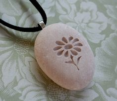 Wild Flower Pendant with cord  Tiny PebbleGlyphc by sjengraving, $20.00