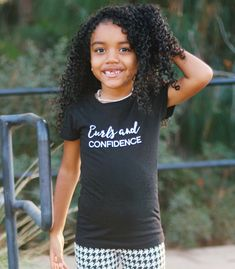 It's never too early to instill confidence in your curly cutie.  Have your little girl rock her curls proudly in this curls and confidence tee.  Pair with jeans and converse, or her favorite skirt!  Tee can be worn alone or layered with a sweater of denim jacket. Shirt details: Available in multiple