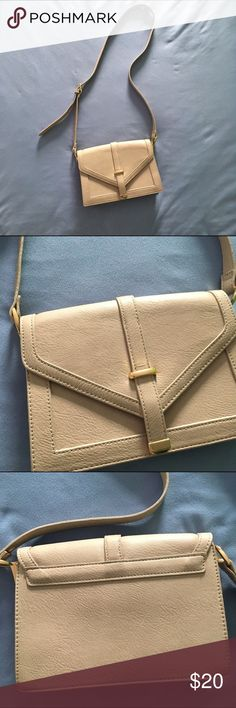 Forever 21 Cross-body Purse Cream cross-body purse with gold-color detail from Forever 21. Adjustable strap length, button-front. Inside is divided into two sections with a zipper pocket and a cellphone pocket. No signs of wear. Great condition. Forever 21 Bags Crossbody Bags