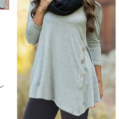 1 HOUR SALE! GRAY TUNIC W/ BUTTON DETAIL! Tunic is Asymmetrical & Has Side Button Accent. Tops