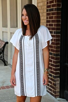 """Model is a 2/3, wearing a small. Model is also 5'4"""" tall. White in color. Dark brown, woven detailing on front. This dress is lined! Polyester/cotton blended. Small 2-4/5, Medium 6-8, Large 10"""