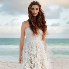 A roundup of the most breathtaking beach wedding dresses. Photo by Patric Shaw for Brides.