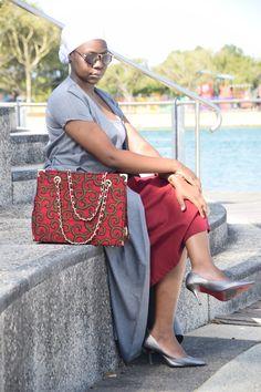 Ankara tote handbag, white headscarf with grey coat and silver/ grey pumps.