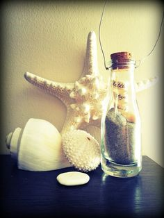 """The memory bottle I made for our living room with a note saying, """"A little piece of our Myrtle Beach vacation... 2012"""" ♥"""