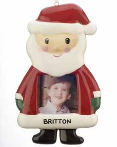 Santa Picture Frame Ornament. Ho ho ho! Wishing you a hearty Merry Christmas is this jolly Santa Claus wearing his traditional red suit, black boots and oversized stocking cap with a white pom pom on the end. Instead of a bowl full of jelly, when this Kris Kringle laughs you see your sweet child's face smiling back at you. This photo frame ornament can be both an ornament with a ribbon hanger or a magnet which is attached to the back for sticking on a computer or refrigerator.. Price: $12.95