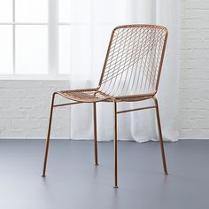 Shop beta rose chair.   Dare to dine up a notch.  Modern metallic lacquers handmade iron frame with woven wire back expertly welded into a graphic linear design.