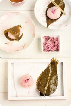 Sakura Mochi (a traditional Japanese dessert consisting of sweat bean paste rice cakes, wrapped in cherry leaves and decorated with cherry blossom flowers.)