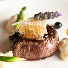 Honey and Pepper Glazed Bison Steak, White Cheddar Grits, Asparagus, and Blueberry Rosemary Gastrique