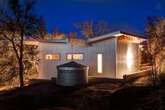 """This tiny home complex outside of Austin, the """"Llano Exit Strategy,"""" has six buildings for four families to visit at any time during the year. Water Catchment, Location Chalet, Tiny House Community, Community Space, Building A Tiny House, Little Cabin, Tiny House Movement, Sustainable Living, The Row"""